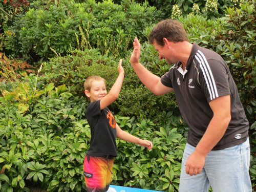 Sharing a hi five with dad