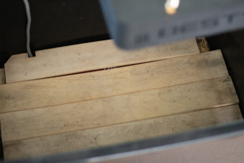 Heat pad covered by wood to help regulate the temp in the grow box